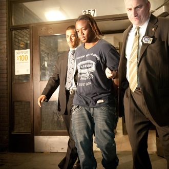 Nov. 11, 2013 - Manhattan, New York, U.S. - COREY DUNTON, 16, of the Bronx, the suspect in the Bryant Park shooting that left two wounded is escorted by detectives from the Midtown South Precinct, Monday, November 11, 2013. COREY DUNTON is expected to be arraigned later tonight. (Credit Image: ? Bryan Smith/ZUMAPRESS.com)