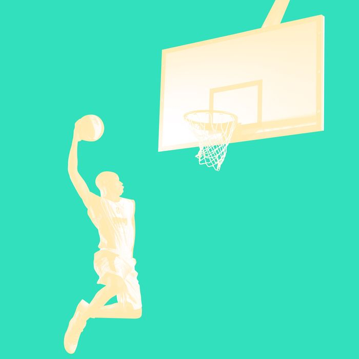 Young man in the air about to dunk the basketball