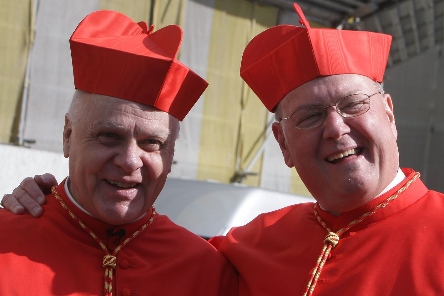 VATICAN CITY, VATICAN - FEBRUARY 18:  Newly appointed cardinals Timothy Michael Dolan (R), Archbishop of New York, and Cardinal Frederick O'Brien (L), Archbishop of Baltimora smile as they leave Saint Peter's Basilica after a ceremony held by Pope Benedict XVI on February 18, 2012 in Vatican City, Vatican.The 84 year old Pontiff installed 22 new cardinals during a ceremony today. These men will be responsible for choosing his sucessor. (Photo by Franco Origlia/Getty Images)