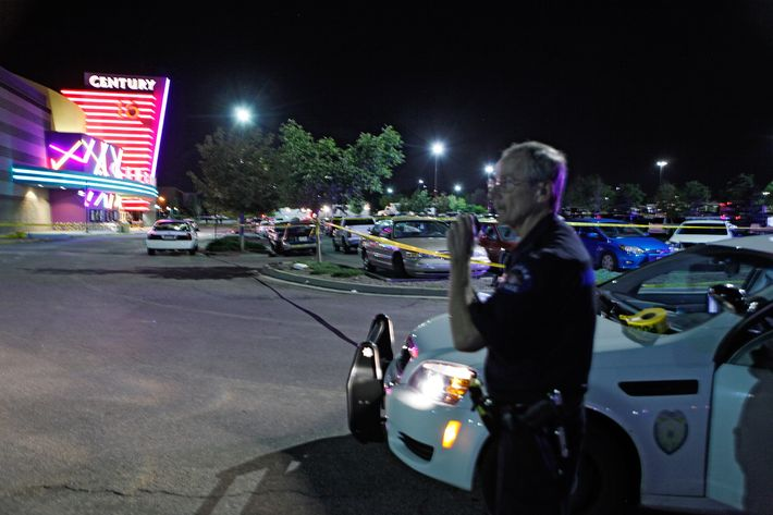 An Aurora Police officer talks on his radio outside of the Century 16 theater at Aurora Mall where as many as 14 people were killed and many injured at a shooting at the Century 16 movie theatre in Aurora, Colo., Friday, July 20, 2012. (AP Photo/Ed Andrieski)