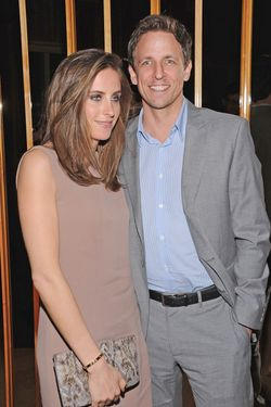 "NEW YORK, NY - MARCH 20:  Alexi Ashe and Seth Meyers attend the party following a screening of ""The Hunger Games"" hosted by The Cinema Society and Calvin Klein Collection at The Top of The Standard on March 20, 2012 in New York City.  (Photo by Dimitrios Kambouris/Getty Images)"