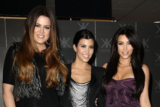 "(L-R) Khloe Kardashian, Kourtney Kardashian and Kim Kardashian promote the ""Kardashian Kollection"" at Sears Cerritos on September 18, 2011 in Cerritos, California."