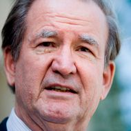 Pat Buchanan speaks about Tim Russert to reporters outside NBC's bureau June 15, 2008 in Washington, DC.