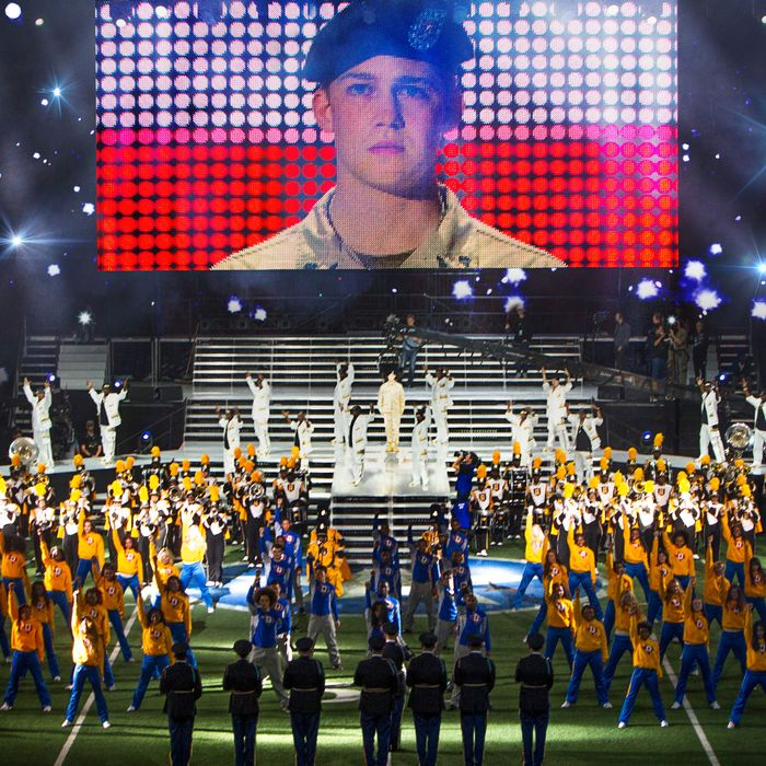 This image released by Sony Pictures shows Joe Alwyn, portraying Billy Lynn, on a screen in a scene from the film,