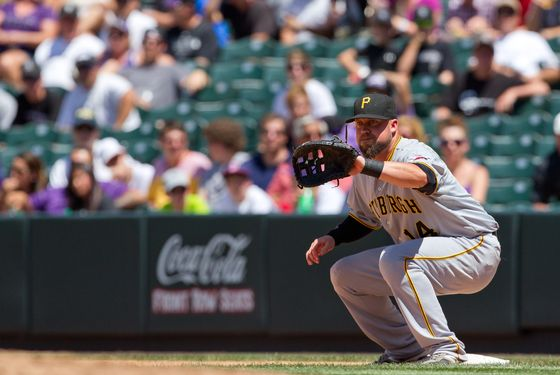 DENVER, CO - JULY 18:  First baseman Casey McGehee #14 of the Pittsburgh Pirates in action against the Colorado Rockies at Coors Field on July 18, 2012 in Denver, Colorado.  The Pirates defeated the Rockies 9-6 to win the three game series.  (Photo by Justin Edmonds/Getty Images)