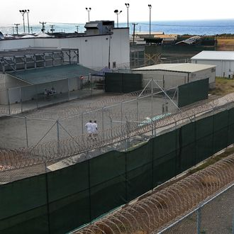Detainees jog in a recreation yard at Camp 6 in the Guantanamo Bay detention center on March 30, 2010 in Guantanamo Bay, Cuba.