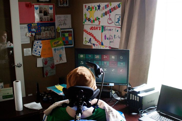Josh Gentry sits in front of his computer, which he can control through eye movements.