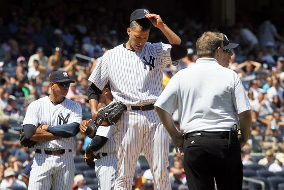 NEW YORK, NY - JUNE 27:  Andy Pettitte #46 of the New York Yankees stands on the mound he is checked on after he was hit with a batted ball in the fifth inning against the Cleveland Indians at Yankee Stadium on June 27, 2012  in the Bronx borough of New York City.  (Photo by Jim McIsaac/Getty Images)