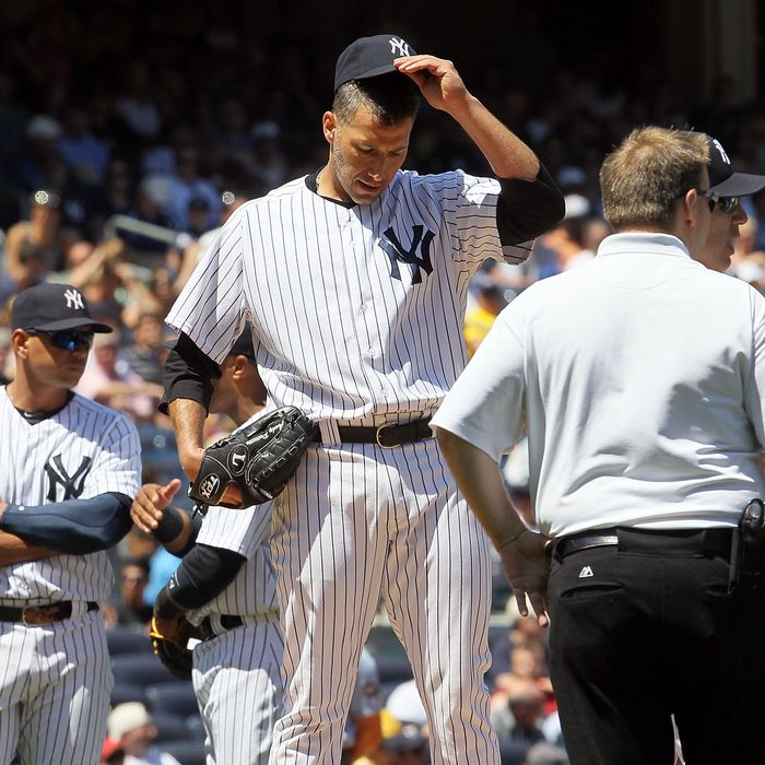 Andy Pettitte #46 of the New York Yankees stands on the mound he is checked on after he was hit with a batted ball in the fifth inning against the Cleveland Indians at Yankee Stadium on June 27, 2012 in the Bronx borough of New York City.
