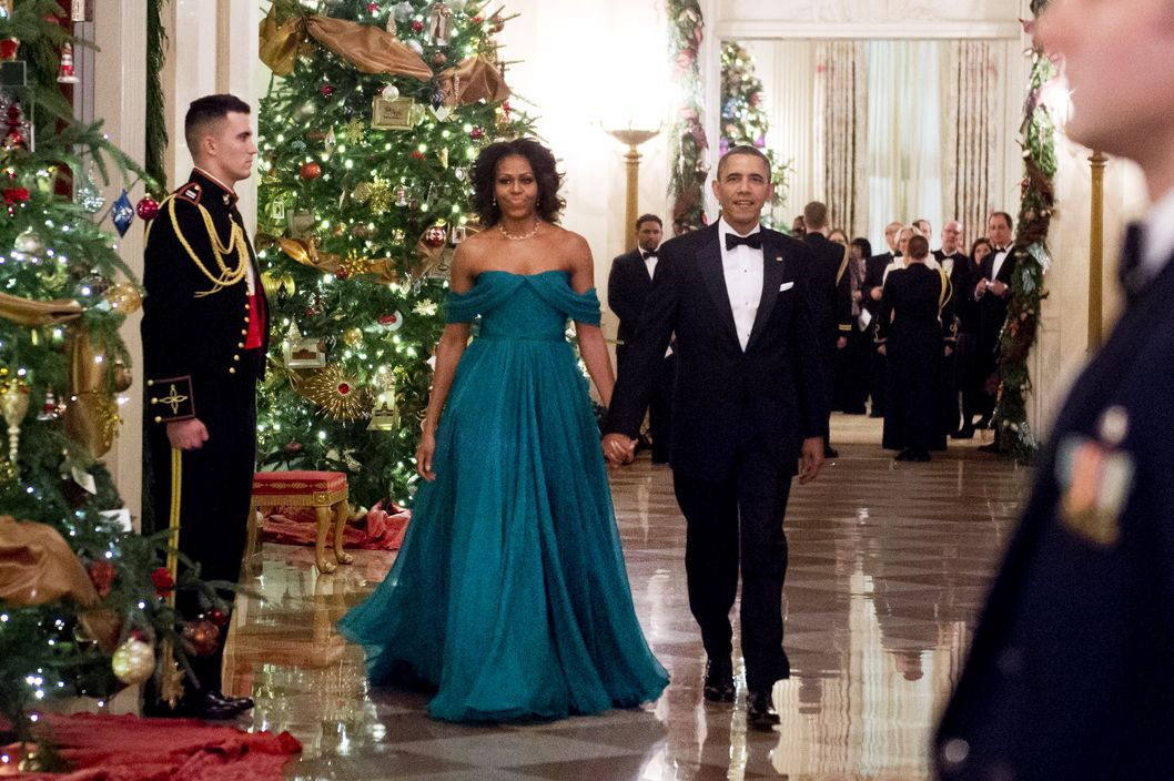 US President Barack Obama and First Lady Michelle Obama arrive for a reception for Kennedy Center Honors recipients in the East Room of the White House in Washington on December 8, 2013. The Kennedy Center Honors recognizes living individuals who have made significant contributions to American culture through performing arts. The 2013 honorees are opera singer Martina Arroyo, musician Herbie Hancock, musician Billy Joel, actress Shirley MacLaine and musician Carlos Santana.
