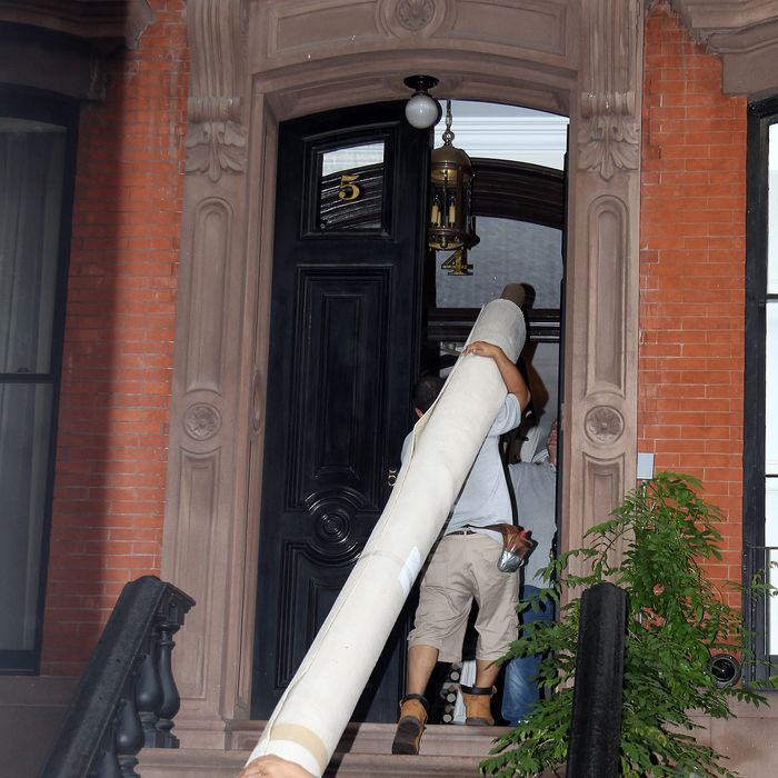 Red carpet brought into Sarah Jessica Parker's house before Obama is due visit to her townhouse in New York City. Other items and secret service were seen entering and leaving the house a day before the President's official visit.