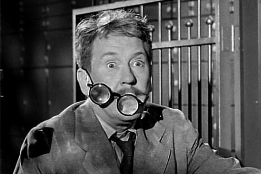 "LOS ANGELES - NOVEMBER 20: Burgess Meredith as Henry Bemis in THE TWILIGHT ZONE episode, ""Time Enough At Last.""  Original air date, November 20, 1959.  Image is a screen grab.  (Photo by CBS via Getty Images) *** Local Caption *** Burgess Meredith"