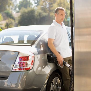 Man filling car at gas station --- Image by ? 237/Tom Merton/Ocean/Corbis