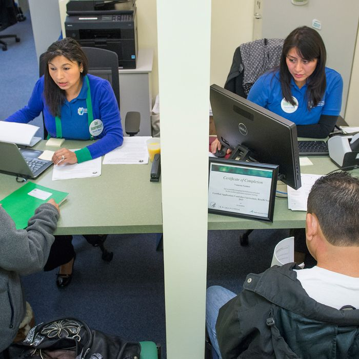 MANASSAS, VA - NOVEMBER 15: Counselors Amelia Kupchyk (L) and Vanessa Gomez (R) help clients with computer work required to navigate the second round of open enrollment for the Affordable Care Act as HHS Secretary Sylvia Burwell tours the Greater Prince William Community Health Center in Manassas, VA on November 15, 2014. HHS Secretary Sylvia Burwell toured the facility as part of a kickoff media blitz. (Photo by Linda Davidson / The Washington Post)