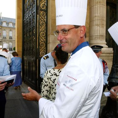 Chef to the President of the United States, Walter Scheib (C) followed by the Italian, Domenico De Cesaris (R), and members of the club - Chefs to Heads of State, shows their identity cards to policeman on arrival at the Elycee Paris to meet Bernadette Chirac, wife of the President, 27 August 2003. Each year since the clubs inception in 1977, the chefs meet in a different country, this year around 30 have come to Paris to chat about their work.  AFP PHOTO/MEHDI FEDOUACH  (Photo credit should read MEHDI FEDOUACH/AFP/Getty Images)