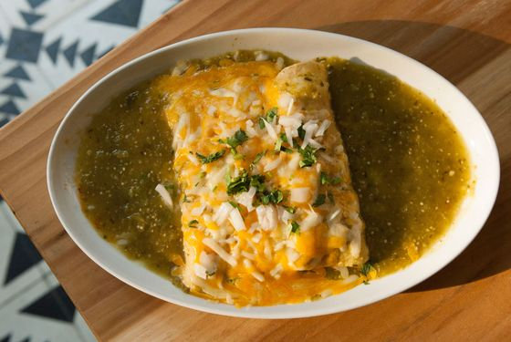 Javelina's Chicken Enchiladas - chipotle-marinated chicken, roasted tomatillo sauce, cheese, and onions.