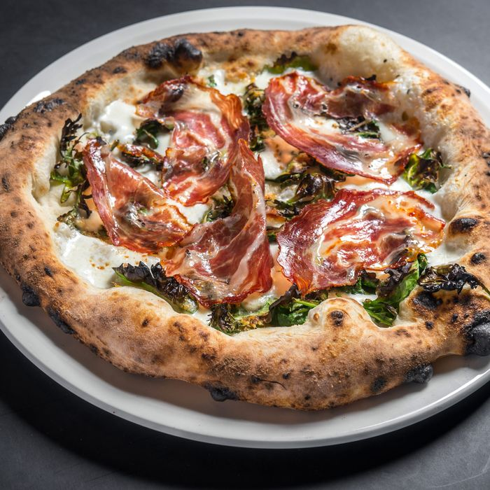Spicy coppa pizza with kale and caciocavallo.