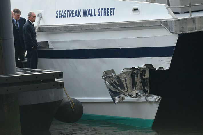 New York Mayor Michael Bloomberg inspects the damage after the commuter ferry slammed into a pier in New York, January 9, 2013. About 50 people were injured when a rush-hour ferry packed with commuters smashed into a pier in New York City on Wednesday, firefighters said. The accident took place at 8:45 am (1345 GMT) on Pier 11 in the East River in lower Manhattan, not far from Wall Street, the New York Fire Department said. The ferry was arriving from New Jersey.