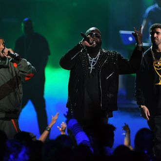 LOS ANGELES, CA - JUNE 26: (L-R) Rappers DJ Khaled, Rick Ross, and singer Drake perform onstage during the BET Awards '11 held at the Shrine Auditorium on June 26, 2011 in Los Angeles, California. (Photo by Kevin Winter/Getty Images)