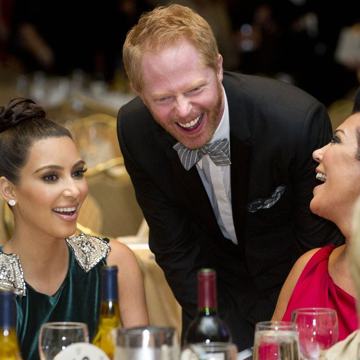 Kris Jenner (R), Kim Kardashian (L) and actor Jesse Tyler Ferguson (C) attend the White House Correspondents Association Dinner in Washington, DC, April 28, 2012. The annual event, which brings together US President Barack Obama, Hollywood celebrities, news media personalities and Washington correspondents, features comedian Jimmy Kimmel as the host. AFP PHOTO / Saul LOEB (Photo credit should read SAUL LOEB/AFP/GettyImages)