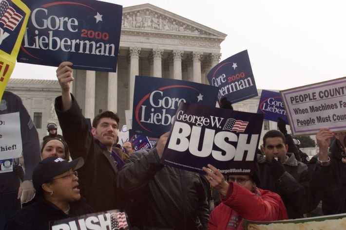 Bush and Gore supporters argue their point to each other in front of the U.S. Supreme Court building December 11, 2000 in Washington, DC.
