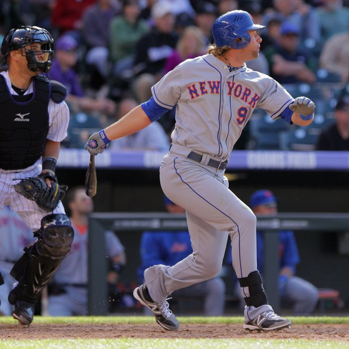 Kirk Nieuwenhuis #9 of the New York Mets hits an RBI double off of Matt Belisle #34 of the Colorado Rockies to score Mike Baxter #23 of the New York Mets in the 10th inning at Coors Field on April 29, 2012 in Denver, Colorado.