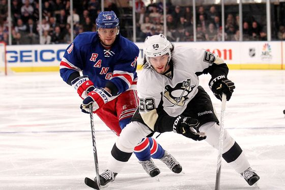 NEW YORK, NY - MARCH 15: Kris Letang #58 of the Pittsburgh Penguins skates with the puck in front of Marian Gaborik #10 of the New York Rangers at Madison Square Garden on March 15, 2012 in New York City.  (Photo by Nick Laham/Getty Images)