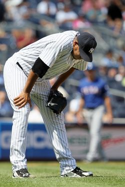 NEW YORK, NY - AUGUST 16: Ivan Nova #47 of the New York Yankees on the mound after he was hit by a batted ball in the fourth inning against the Texas Rangers at Yankee Stadium on August 16, 2012 in the Bronx borough of New York City. (Photo by Jim McIsaac/Getty Images)