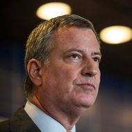 New York City Mayor Bill de Blasio speaks at a press conference after witnessing police being retrained with new guidelines at the Police Academy  on December 4, 2014 in the College Point neighborhood of the Queens borough of in New York City.