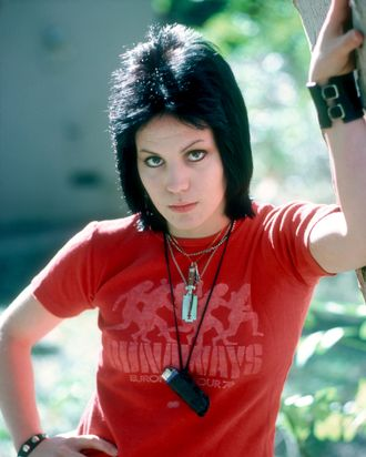 It's a lighter on a necklace! It's on Joan Jett!