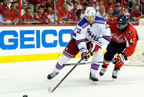 WASHINGTON, DC - MAY 09:  Joel Ward #42 of the Washington Capitals and Anton Stralman #32 of the New York Rangers battle for the puck in Game Six of the Eastern Conference Semifinals during the 2012 NHL Stanley Cup Playoffs at Verizon Center on May 9, 2012 in Washington, DC.  (Photo by Patrick McDermott/Getty Images)