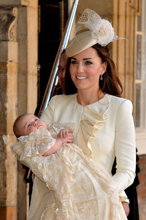 LONDON, ENGLAND - OCTOBER 23:   (EDITORS NOTE: Retransmission with alternate crop.) Catherine, Duchess of Cambridge carries her son Prince George Of Cambridge after his christening at the Chapel Royal in St James's Palace, ahead of the christening of the three month-old Prince George of Cambridge by the Archbishop of Canterbury on October 23, 2013 in London, England. (Photo by John Stillwell - WPA Pool /Getty Images)