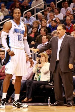 ORLANDO, FL - JANUARY 24:  Head coach Stan Van Gundy of the Orlando Magic talks with Dwight Howard #12 during the game against the Detroit Pistons at Amway Arena on January 24, 2011 in Orlando, Florida.  NOTE TO USER: User expressly acknowledges and agrees that, by downloading and or using this Photograph, user is consenting to the terms and conditions of the Getty Images License Agreement.  (Photo by Sam Greenwood/Getty Images) *** Local Caption *** Dwight Howard;Stan Van Gundy