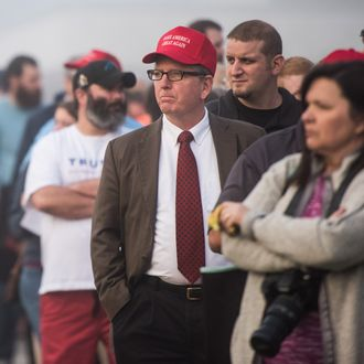 Donald Trump supporters wait in line before a campaign rally for the Republican presidential candidate at Lenoir-Rhyne University March 14, 2016 in Hickory, North Carolina.