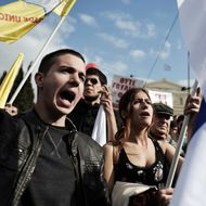 Protesters chant slogans during a massive anti-austerity rally in front of the Greek parliament in Athens on November 1, 2014.