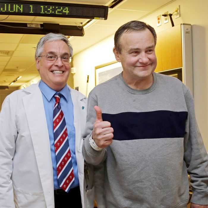 Thomas Manning (right) with Mass General nurse Anthony DiGiovine.