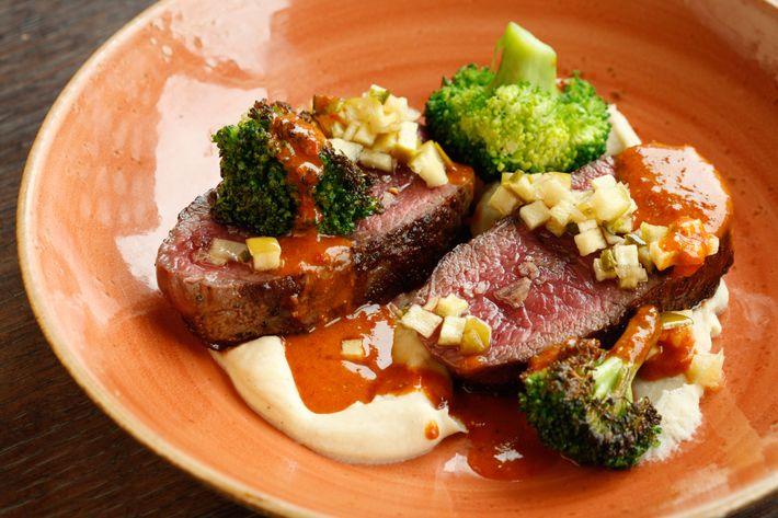 Pan-roasted venison with cardamom celery root, ginger broccoli, and housemade harissa.