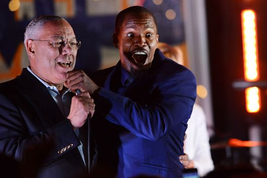 EAST HAMPTON, NY - AUGUST 24:  Colin Powell and Jamie Foxx perform at the 4th Annual Apollo In The Hamptons Benefit on August 24, 2013 in East Hampton, New York.  (Photo by Shahar Azran/WireImage)