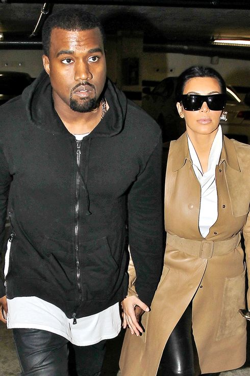Kim Kardashian and Kanye West arriving at a medical building in Beverly Hills, December 22, 2012.