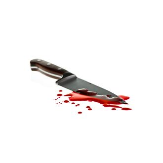 Red blood splatter with kitchen knife, shallow DOF