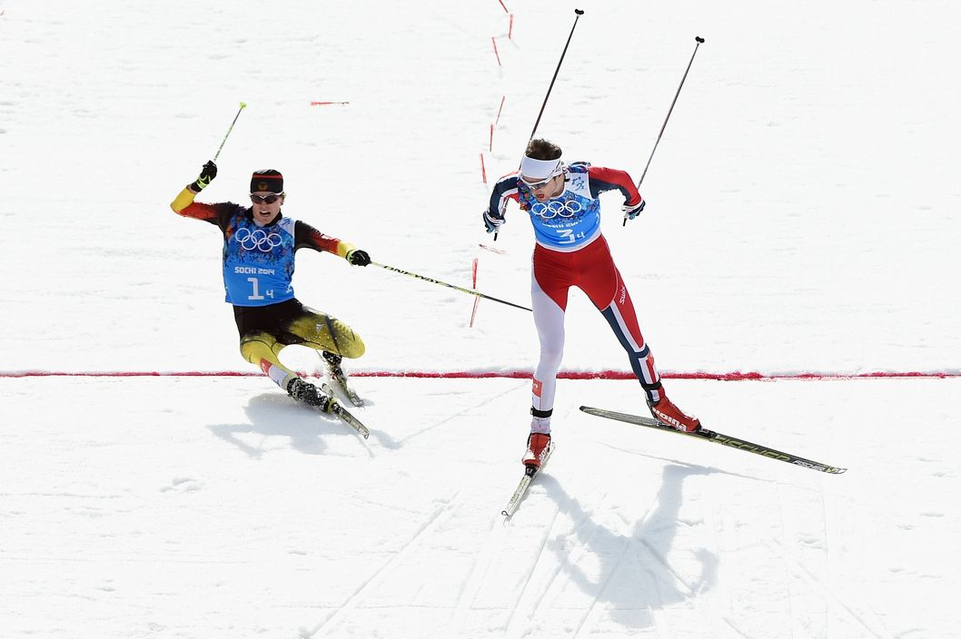 SOCHI, RUSSIA - FEBRUARY 20:  Joergen Graabak of Norway (R) narrowly beats Fabian Riessle of Germany in the Nordic Combined Men's Team 4 x 5 km during day 13 of the Sochi 2014 Winter Olympics at RusSki Gorki Jumping Center on February 20, 2014 in Sochi, Russia.  (Photo by Lars Baron/Getty Images)