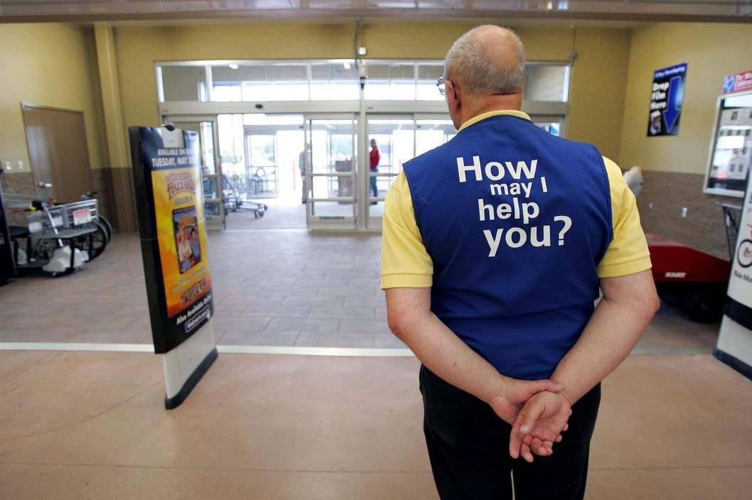 A Walmart greeter waits to welcome new customers to a store in Bowling Green, Ohio.