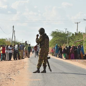 A Kenya Defence Forces soldier stands guard before they ended a siege by gunmen in the university campus of the northeastern town of Garissa on April 2, 2015. At least 70 students were massacred when Somalia's Shebab Islamist group attacked a Kenyan university today, the interior minister said, the deadliest attack in the country since US embassy bombings in 1998.