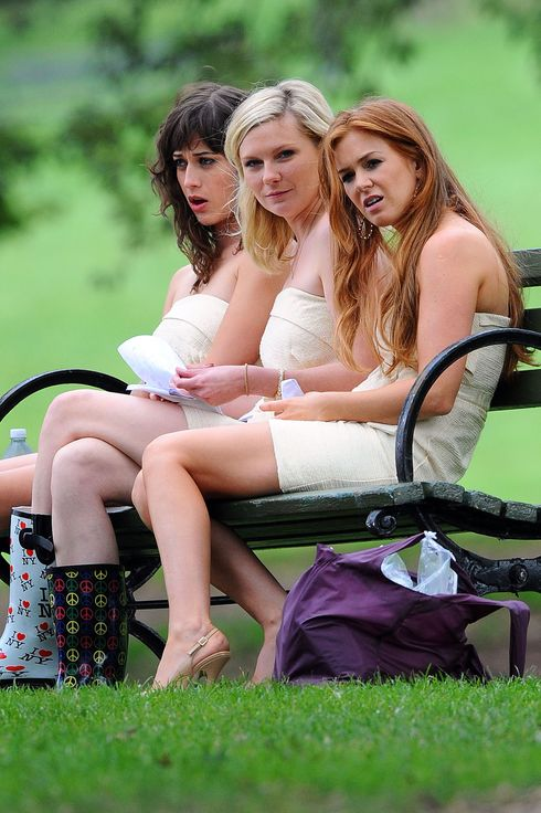 "Celebrities on location for ""Bachelorette"" in Prospect Park, Brooklyn. <P> Pictured: Lizzy Caplan, Kirsten Dunst and Isla Fisher <P> <P><B>Ref: SPL318256  210911  </B><BR/> Picture by: Doug Meszler / Splash News<BR/> </P><P> <B>Splash News and Pictures</B><BR/> Los Angeles:	310-821-2666<BR/> New York:	212-619-2666<BR/> London:	870-934-2666<BR/> photodesk@splashnews.com<BR/> </P>"