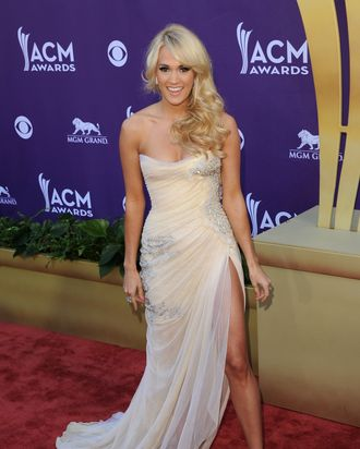 LAS VEGAS, NV - APRIL 01: Singer Carrie Underwood arrives at the 47th Annual Academy Of Country Music Awards held at the MGM Grand Garden Arena on April 1, 2012 in Las Vegas, Nevada. (Photo by Jason Merritt/Getty Images)