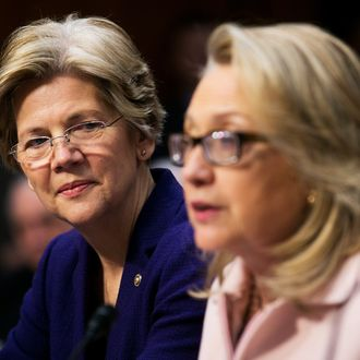 Senator Elizabeth Warren, a Democrat from Massachusetts, left, looks on as U.S. Secretary of State Hillary Clinton speaks during a Senate Foreign Relations Committee nomination hearing in Washington, D.C., U.S., on Thursday, Jan. 24, 2013. Senator John Kerry stressed the need to prevent Iran from acquiring nuclear weapons. He described the