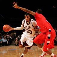 NEW YORK - JANUARY 13:  Chris Gaston #33 of the Fordham Rams handles the ball against Josh Benson #44 of the Dayton Flyers at Madison Square Garden on January 13, 2010 in New York, New York.  (Photo by Mike Lawrie/Getty Images) *** Local Caption *** Chris Gaston;Josh Benson