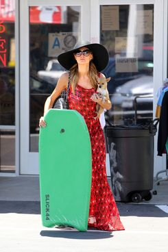 Paris Hilton buys a boogie board in Malibu after stocking up on alcohol. Hilton had the liquor store deliver a number of cases to her residence while she walked out with a boogie board in hand along with her dog.<P>Pictured: Paris Hilton<P><B>Ref: SPL795669  060714  </B><BR/>Picture by: KAMINSKI / Splash News<BR/></P><P><B>Splash News and Pictures</B><BR/>Los Angeles:	310-821-2666<BR/>New York:	212-619-2666<BR/>London:	870-934-2666<BR/>photodesk@splashnews.com<BR/></P>