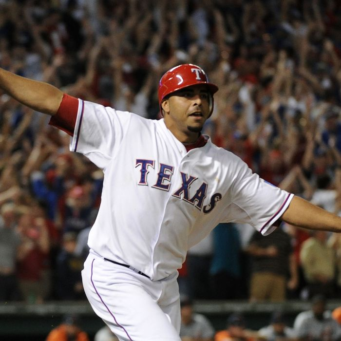 ARLINGTON, TX - OCTOBER 10: Nelson Cruz #17 of the Texas Rangers runs the bases after hitting a walk off grand slam home run in the bottom of the 11th inning to win Game Two of the American League Championship Series 7-3 against the Detroit Tigers at Rangers Ballpark in Arlington on October 10, 2011 in Arlington, Texas. (Photo by Harry How/Getty Images)