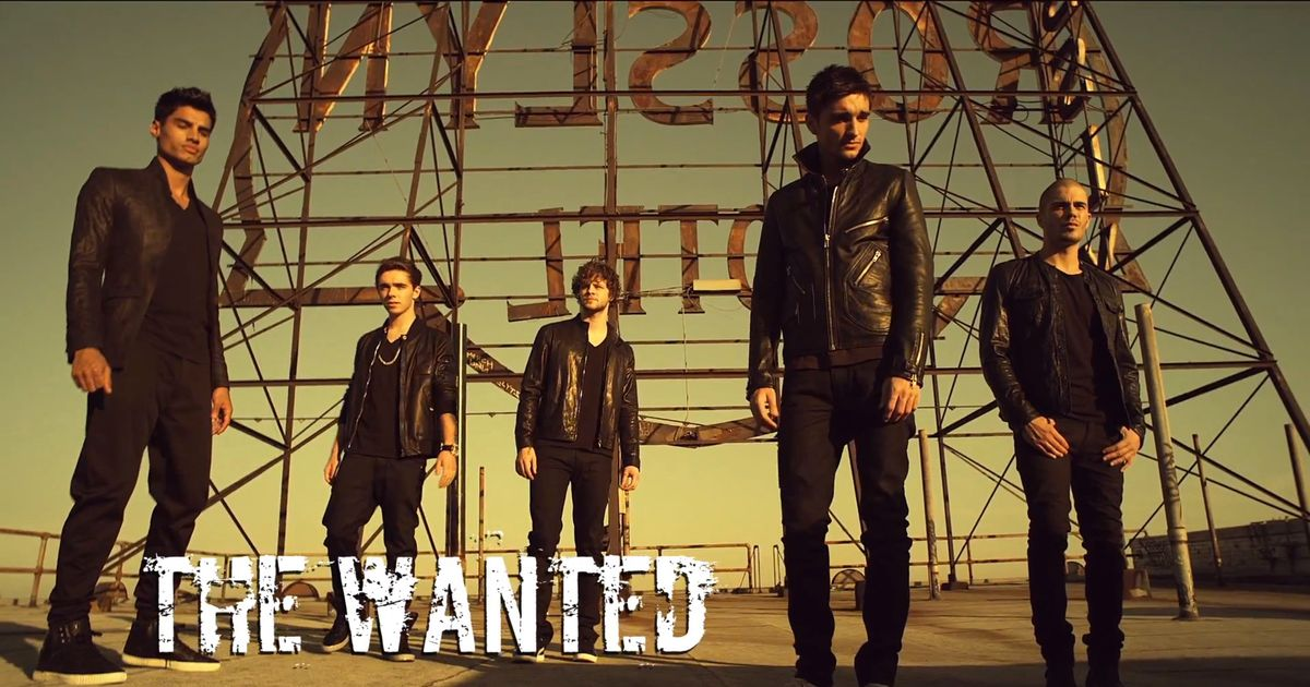 The wanted chasing the sun logo